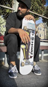 Alán with the FTC skateboard he designed for TOO $HORT